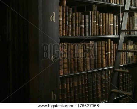 Antique books and a ladder in a library in Dublin Ireland.