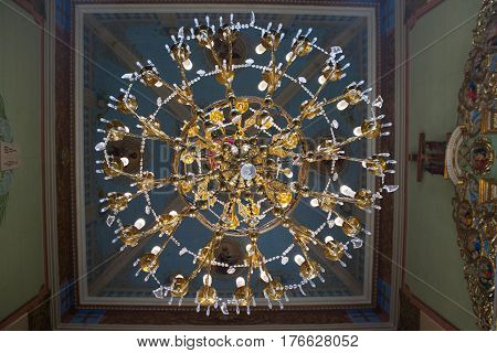 Large gold chandelier in the Church glass