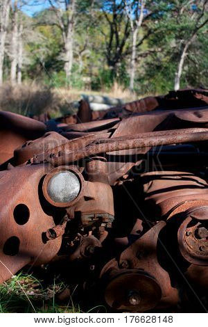 The rusted ruins of an old automobile left to rust.