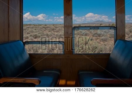 Seating for passengers inside of the historic Cumbres and Toltec Railroad steam engine train.