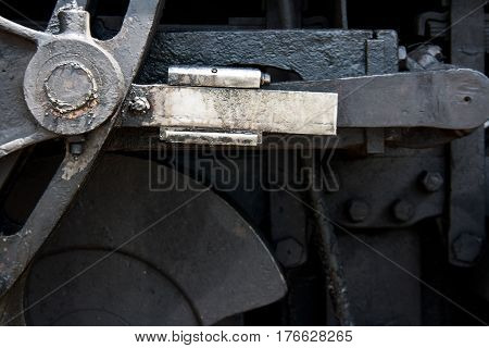 Detail of the mechanics of a steam engine train.