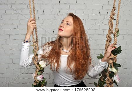 A girl with red hair smiles in profile