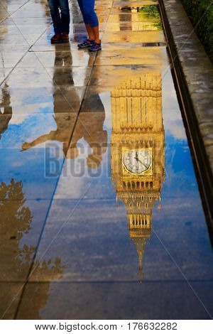 Big Ben Clock Tower puddle water reflection in London England