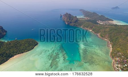 Aerial drone photo of sea and coastline from iconic tropical beach of Phi Phi island, Thailand