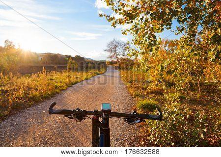 Bike at Parque de Turia of Valencia park sunset near Ribarroja in Spain