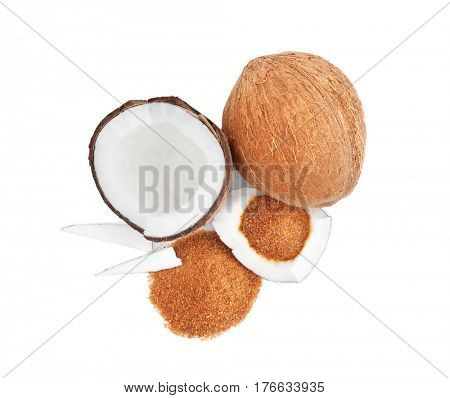 Heap of brown sugar and coconut on white background