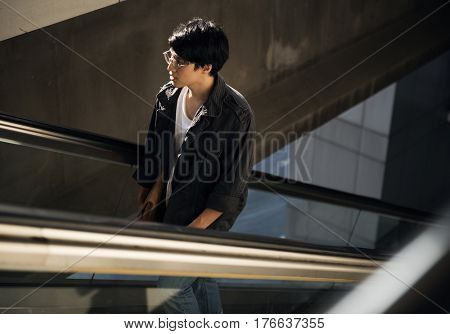 Young asian using escalator routine life