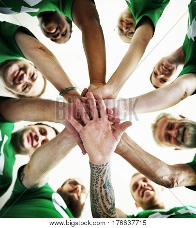 Group of people holding hand assemble togetherness from underneath