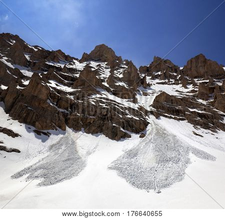Snowy Rocks And Trace From Avalanche In Spring