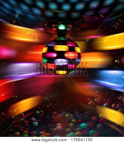 Colorful disco ball rotating light spot reflections on wall and floor