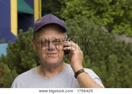 Happy Senior Talking On His Cellphone