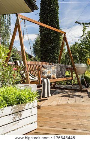 Villa Patio With Wooden Garden Swing