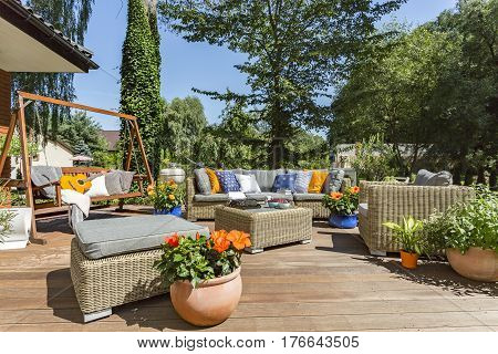 Spacious Villa Terrace With Rattan Furniture