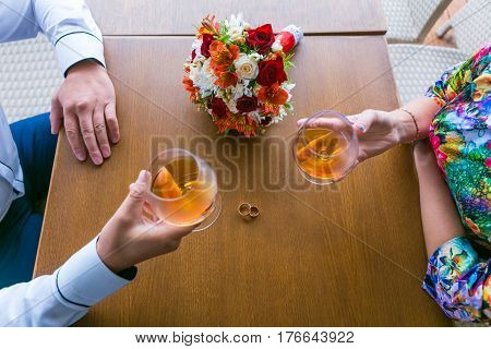 wedding background bouquet and glasses with cognac