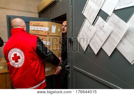 Uzhhorod Ukraine - March 16 2017: Employees of the Red Cross Society unload boxes of measles vaccines that entered the Transcarpathian region within the framework of humanitarian aid from Hungary.