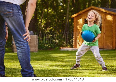 Boy Playing Ball With Father