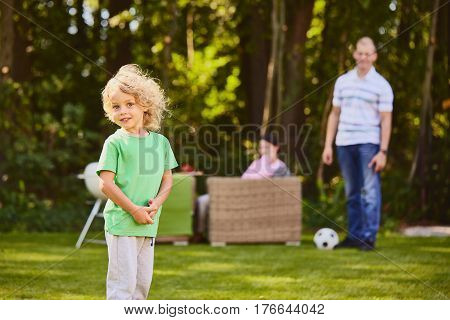 Small Child In Garden