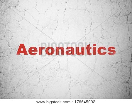 Science concept: Red Aeronautics on textured concrete wall background