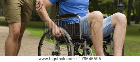 Man On Wheelchair With Friend In Park