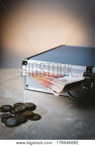 a suitcase full of money and coins