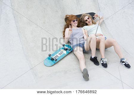 Girls Lying On The Vert Ramp And Taking Selfie
