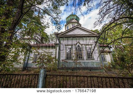 Exterior of Orthodox church in Krasne deserted village of Chernobyl Exclusion Zone Ukraine