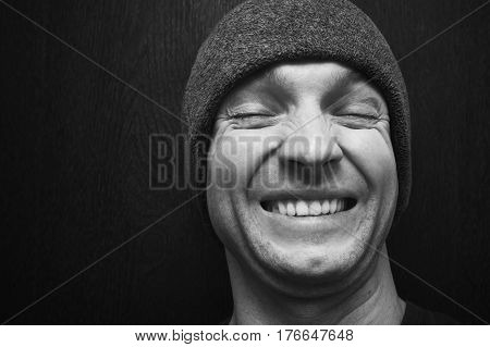 Young Laughing Man In Gray Hat