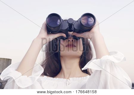 Young Brunette Woman Watching With Binoculars.