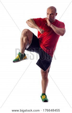 Studio Portrait Of Fighting Muscular Man Over White Background