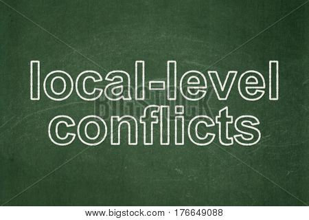 Politics concept: text Local-level Conflicts on Green chalkboard background