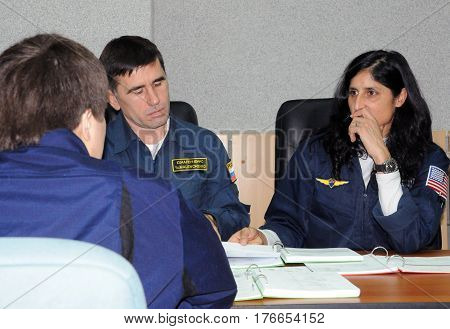 BAIKONUR KAZAKHSTAN - DECEMBER 15: Increment 31 backup crewmembers Yuri Malenchenko (left Russia) and Sunita Williams (USA) at prelaunch class at Baikonur cosmodrome