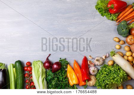 Vegetables. Tomato, cucumber and carrot. Celery, zucchini and eggplant. Potatoes, onion and garlic. Pepper, brocoli and salad, squash. Parsley. Organic food with copy space.