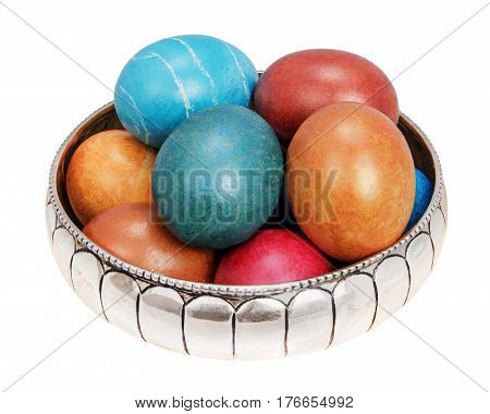 colors eggs in silver vase isolated on white background