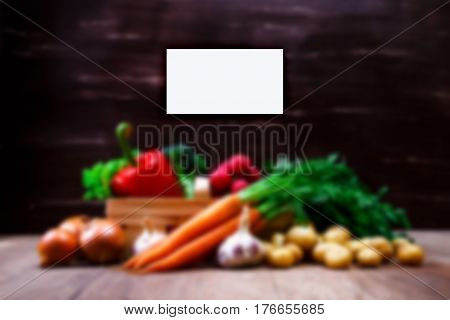 Business card mockup. Vegetables. Potatoes, carrot and red pepper. Lettuce salad, garlic and brocoli. Onion and radish.