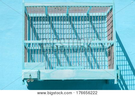 Empty Wooden Birdcage Hanging On Wall