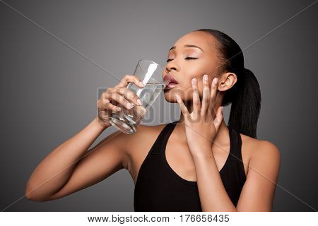 Happy Healthy Black Asian Woman Enjoying Water