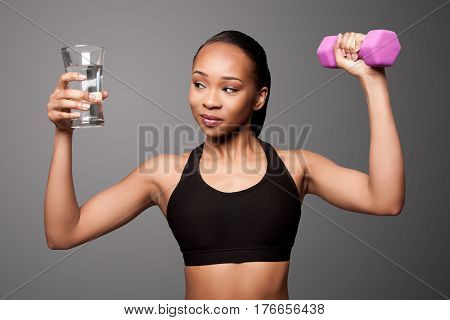 Happy Healthy Black Asian Woman With Water And Dumbbell