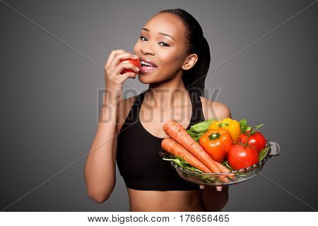 Happy Healthy Black Asian Woman Eating Vegetables