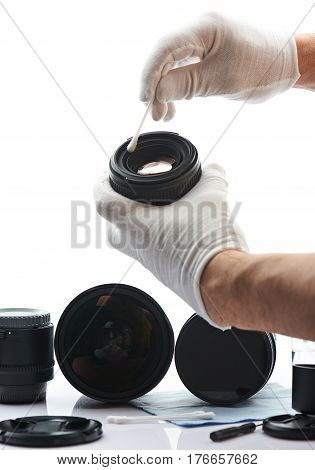 Closeup Of Hand Cleaning Lens