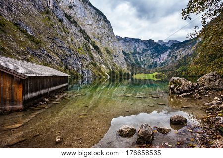 The concept of active tourism and ecotourism. Lake Obersee in the Bavarian Alps. Boat garage in the middle of the lake