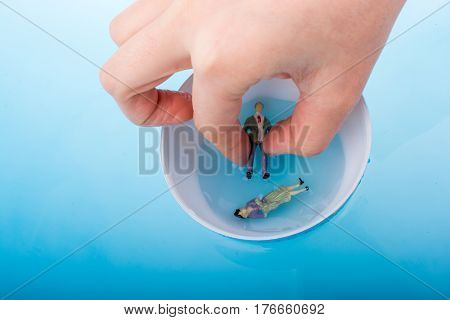 Little Globe With  Figurines  Floating In Water