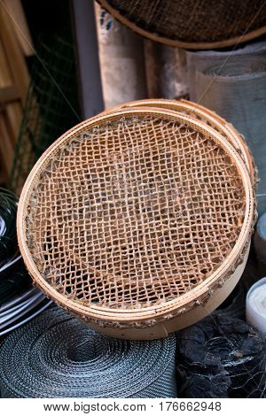 Traditional type sieve made of wood on a background