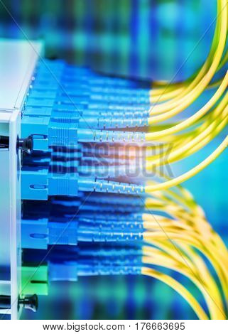 optical fiber telecommunication equipment and patchcords inside a network infrastructure.