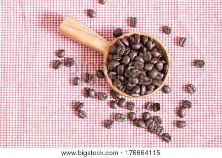 Coffee beans on red striped fabric,top view