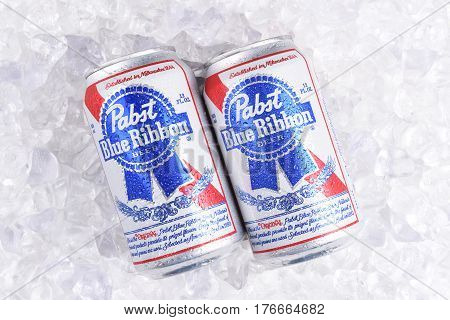 IRVINE CALIFORNIA - MARCH 16 2017: Pabst Blue Ribbon Beer. Two cans of the American brand on a bed of ice introduced in 1884 in Milwaukee currently based in Los Angeles.