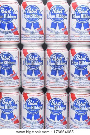 IRVINE CALIFORNIA - MARCH 16 2017: Pabst Blue Ribbon Beer. Twelve stacked cans of the American brand introduced in 1884 in Milwaukee currently based in Los Angeles.