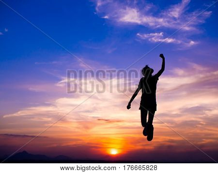 Silhouette of woman jumping success and Happiest moments at sunset and feeling free.