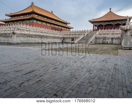 Beijing, China - Oct 30, 2016: At the Forbidden City (Gu Gong, Palace Museum). The Hall of Supreme Harmony (Taihedian) sits elevated on tiered terraces (left). The Hall of Central Harmony (Zhonghedian) to right.