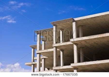 incomplete building against blue sky