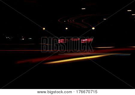 in motion tail lights street scene night abstract background